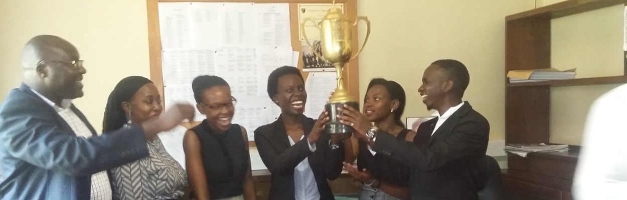 L-R:  The Ag. Deputy Principal Dr. Ronald Naluwairo , The A.g. Director HURIPEC, Dr. Zahara Nampewo jubilant with the winning team